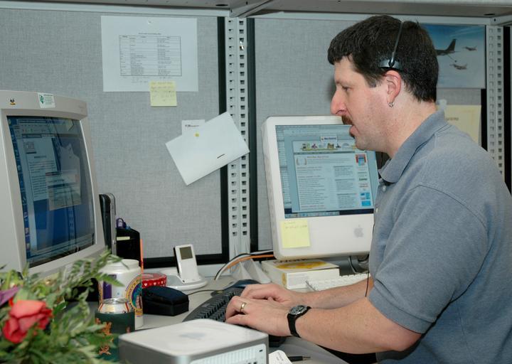 člověk, který potřebuje ke své práci počítač